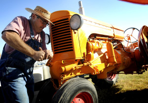 Monte Soukup of Lawrence turns the crank on his 1945 model Minneapolis Moline model U tractor during the educational day at the Central Kansas Flywheels Yesteryear Museum on Friday, Oct. 9, 2010. . (photo by Jeff Cooper/ Salina Journal)