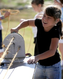 Jenna Niland a fourth grader at Eisenhower Elementary in McPherson strains to turn the crank while spinning rope at the Central Kansas Flywheels Educational Day on Friday, Oct. 8, 2010. The event was for students from local and regional schools. (photo by Jeff Cooper/ Salina Journal)
